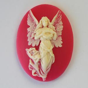 Lucite röd ängel